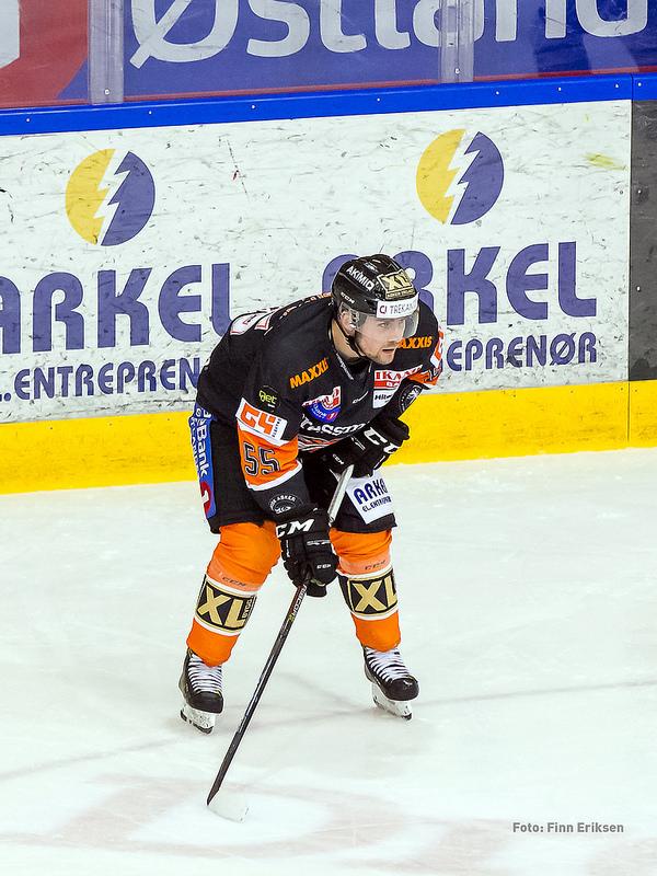 Endre Medby foran Arkels vant-reklame